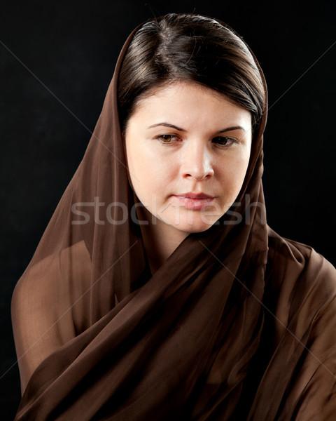 Woman wearing scarf on black Stock photo © igabriela