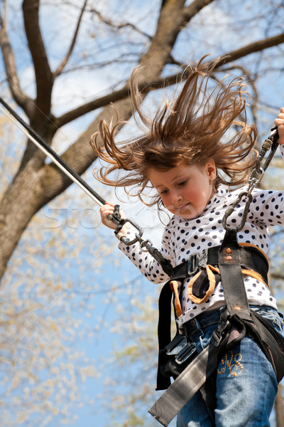 Little girl in a bungee Stock photo © igabriela