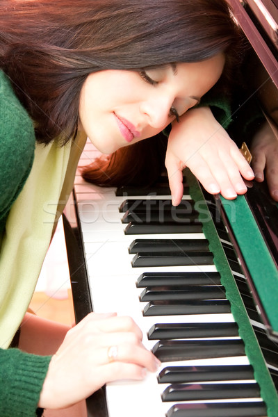 Portrait of a beautiful brunette and her piano Stock photo © igabriela