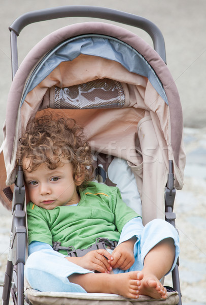 Baby boy outdoor in stroller Stock photo © igabriela