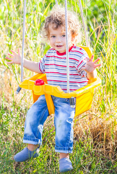 Baby boy in a swing Stock photo © igabriela