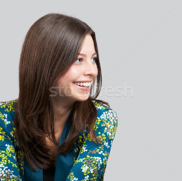 Derűs fiatal nő portré szürke nő pihen Stock fotó © igabriela