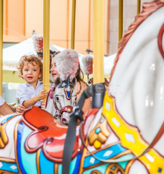 Baby boy in a carousel Stock photo © igabriela