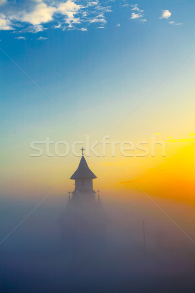 Morning mist over the church Stock photo © igabriela