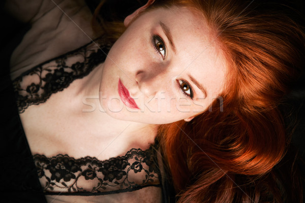 Low key portrait of a young woman Stock photo © igabriela