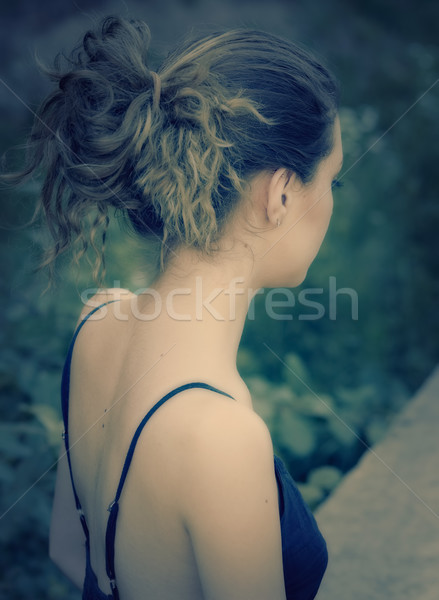 Young woman's back in romantic light outdoor Stock photo © igabriela