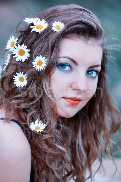 Woman with flowers in her hair Stock photo © igabriela