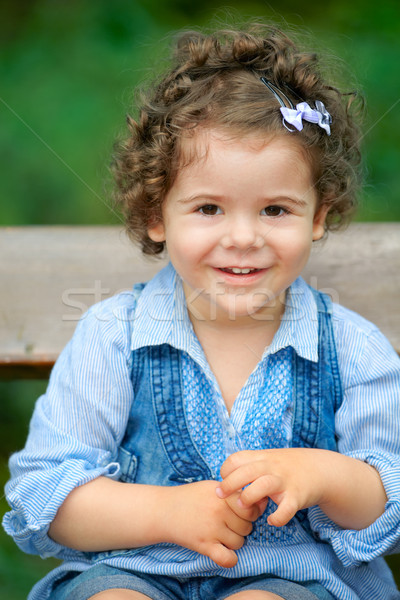 Baby girl sitting on a bench Stock photo © igabriela