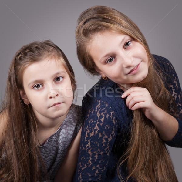 Lánytestvér portrék stúdió portré 10 éves nővérek Stock fotó © igabriela