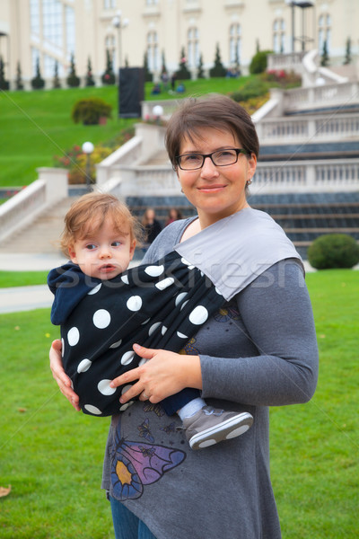 Baby boy in sling in mothers arms Stock photo © igabriela