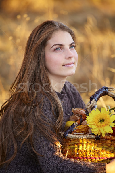 Young woman with flower basket Stock photo © igabriela