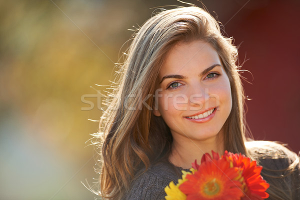 Young woman with flowers Stock photo © igabriela