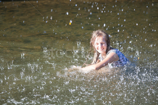 Young woman in a river Stock photo © igabriela