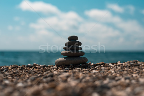 Stack of round smooth stones on a seashore Stock photo © igor_shmel