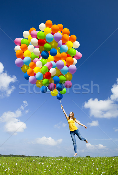 Repülés léggömbök boldog fiatal nő tart színes Stock fotó © iko