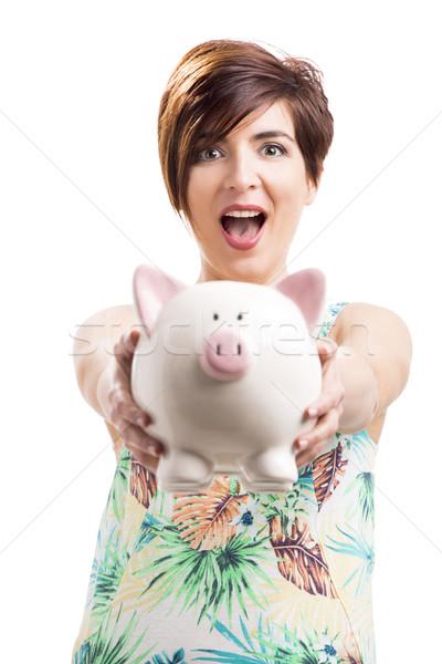 Beautiful woman showing a piggybank Stock photo © iko