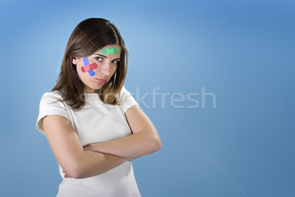 Woman with bandages on the face Stock photo © iko