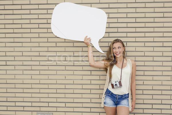 Huncut lány gyönyörű fiatal tinédzser tart Stock fotó © iko
