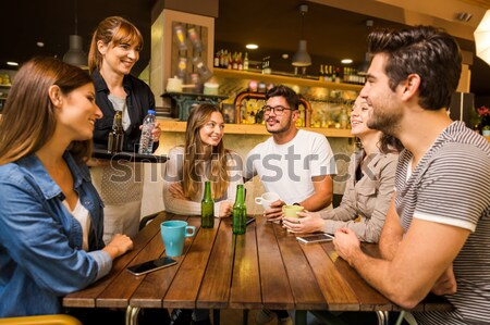 Social no grupo amigos restaurante todo Foto stock © iko