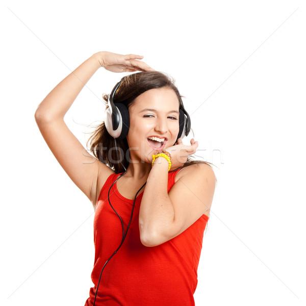 Genç kız dinlemek müzik kız yalıtılmış beyaz Stok fotoğraf © iko