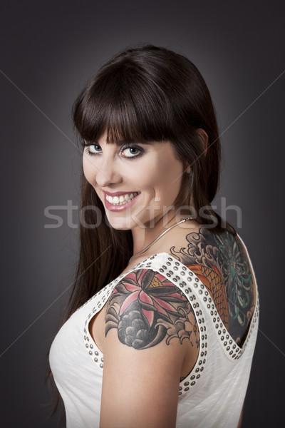 Vrouw glimlachen portret mooie jonge vrouw tattoo vrouwen Stockfoto © iko