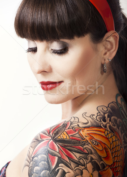 Stock photo: Vintage woman with a tattoo