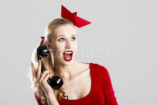 Fashion woman with a phone Stock photo © iko