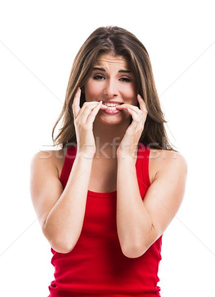 Lány harap körmök gyönyörű fiatal nő izolált Stock fotó © iko