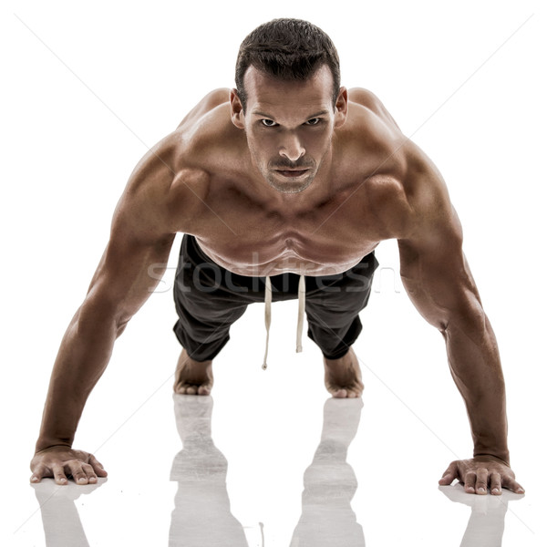 Muscle man making pushups Stock photo © iko
