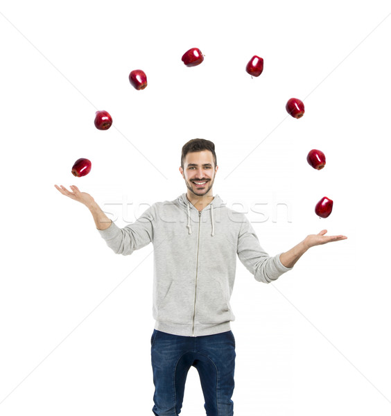 Happy man juggling with apples  Stock photo © iko
