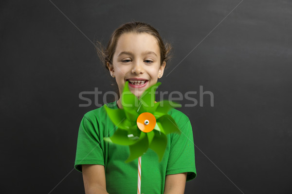 Stock photo: Little girl holding a windmill