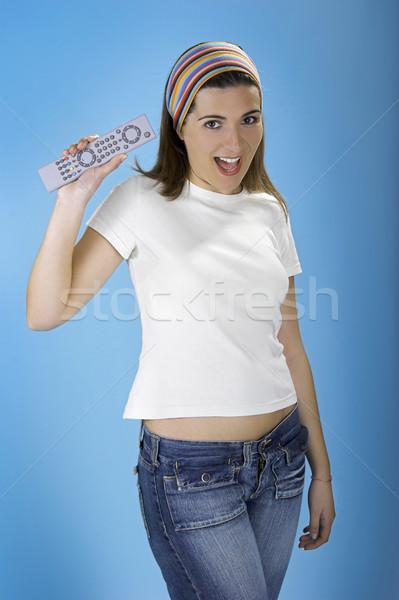 Controle remoto mulher azul música digital feminino Foto stock © iko