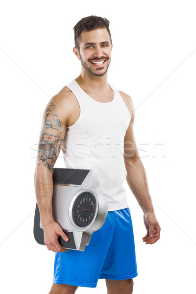 Hombre joven escala sonrisa Foto stock © iko