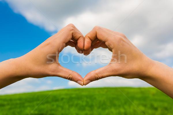 Kezek készít szív alak női kéz gyönyörű Stock fotó © iko