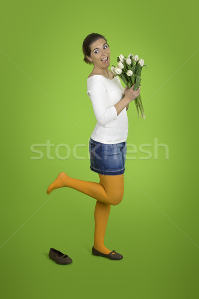 Happy girl with tulips Stock photo © iko