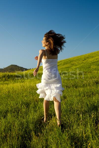 Young woman running on a beautiful springfield  Stock photo © iko