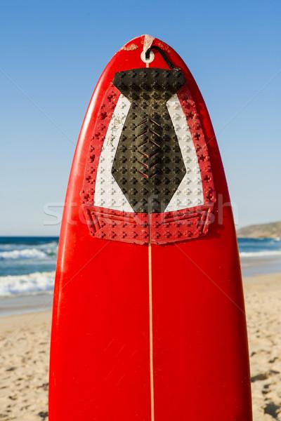 Piros szörfdeszka homok gyönyörű napos idő sport Stock fotó © iko
