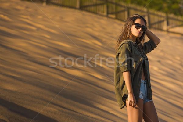 женщину песчаная дюна красивой позируют девушки Сток-фото © iko