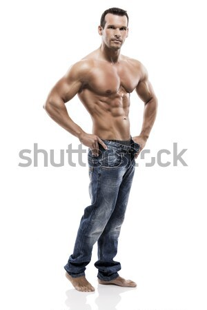 Muscle man posing in studio, isolated over a white background Stock photo © iko