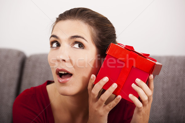 Trying to guess what is inside the present Stock photo © iko