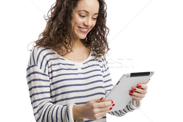 Sempre bella ragazza felice lavoro tablet isolato Foto d'archivio © iko