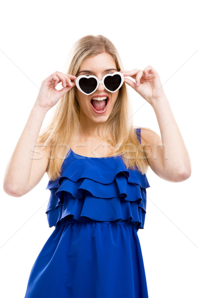 Woman in blue with sunglasses Stock photo © iko