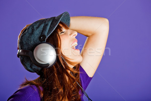 Stock photo: Beautiful woman listening music
