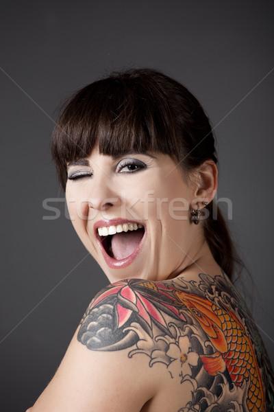 Kacsintás szemek portré gyönyörű fiatal nő tetoválás Stock fotó © iko