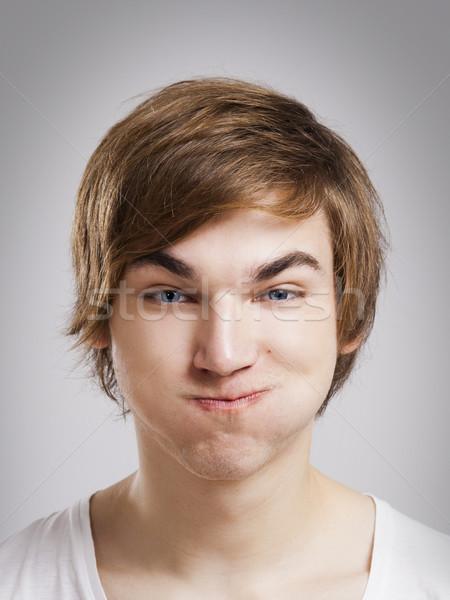 Grap gezicht portret knap jonge man grijs Stockfoto © iko