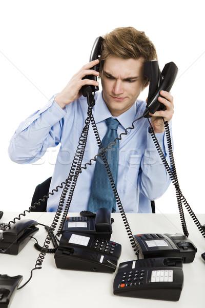 Többszörös idő fiatalember iroda néhány telefonok Stock fotó © iko
