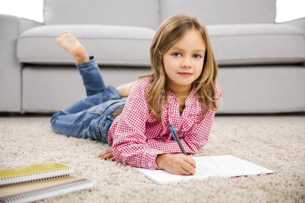 Little girl making homework Stock photo © iko