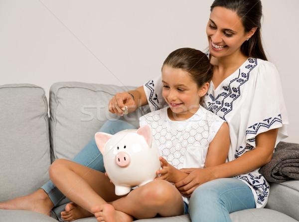 дочь экономия матери монетами Piggy Bank Сток-фото © iko
