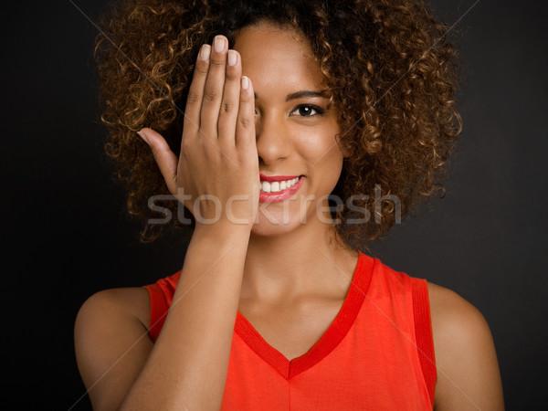 Zobaczyć piękna uśmiechnięta kobieta oka Zdjęcia stock © iko