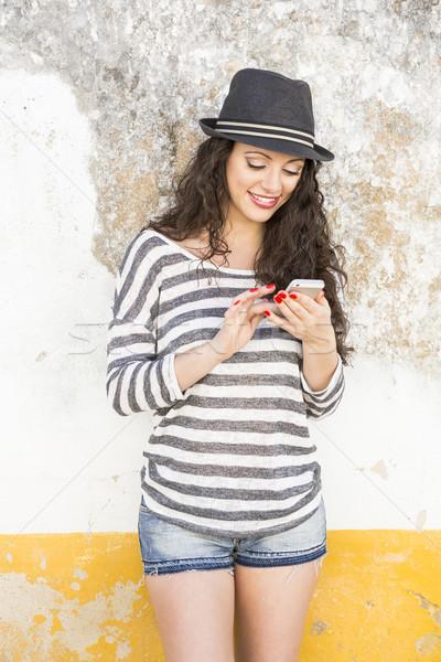 Sending a text message Stock photo © iko